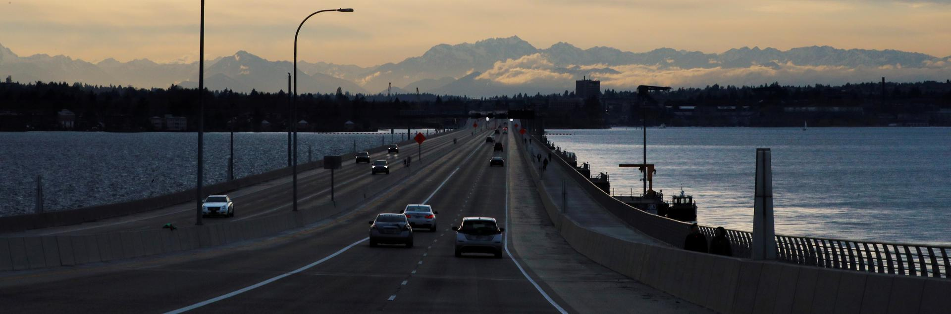 A few cars drive on a nearly empty highway, amid the coronavirus disease (COVID-19) outbreak, on the road in to Seattle, Washington, U.S., March 22, 2020. REUTERS/Brian Snyder