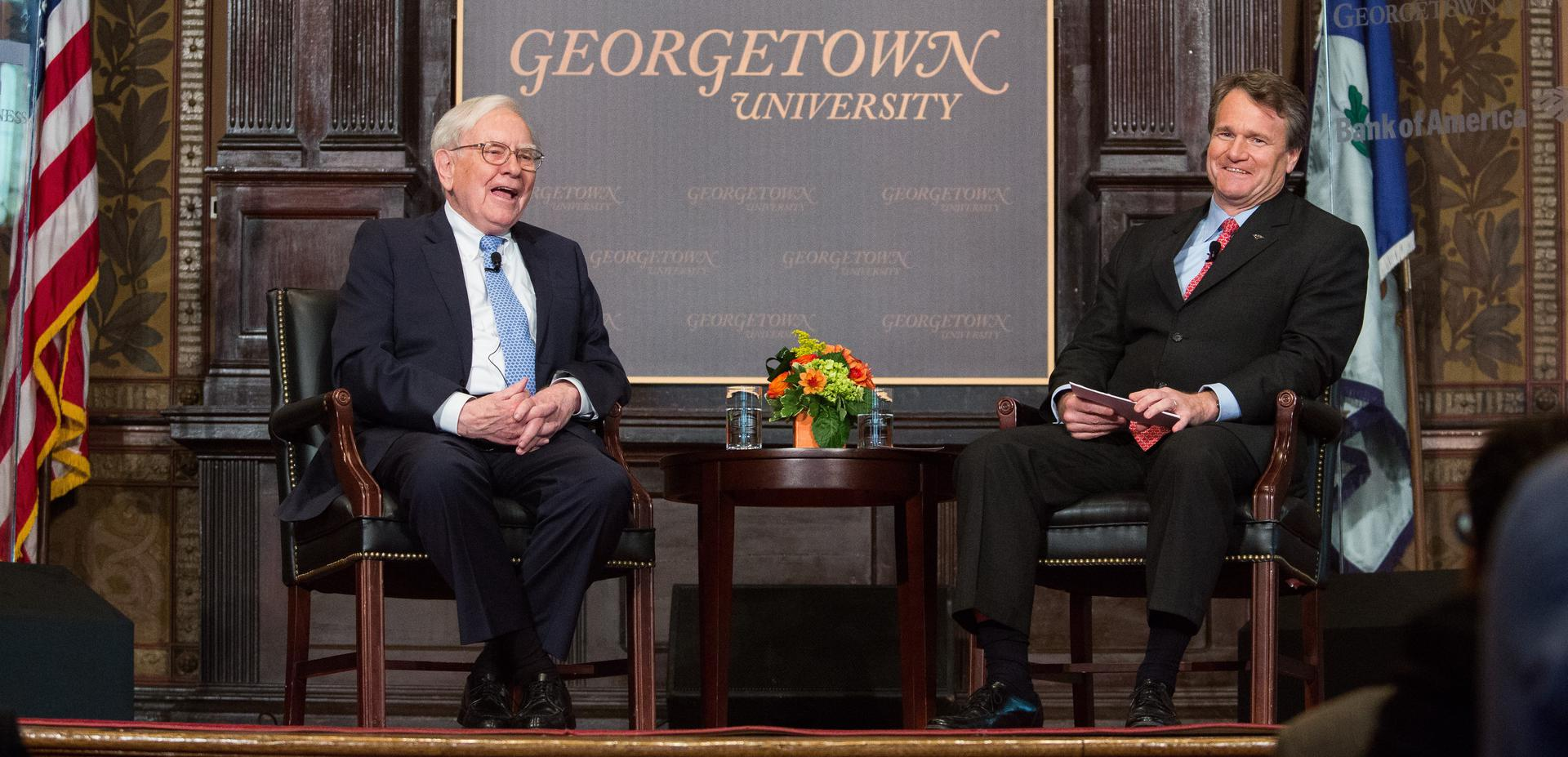 Warren Buffett speaks with Bank of America CEO Brian Moynihan in Gaston Hall at Georgetown University, September 19, 2013 in Washington, DC.  (Photo by Drew Angerer/Getty Images)