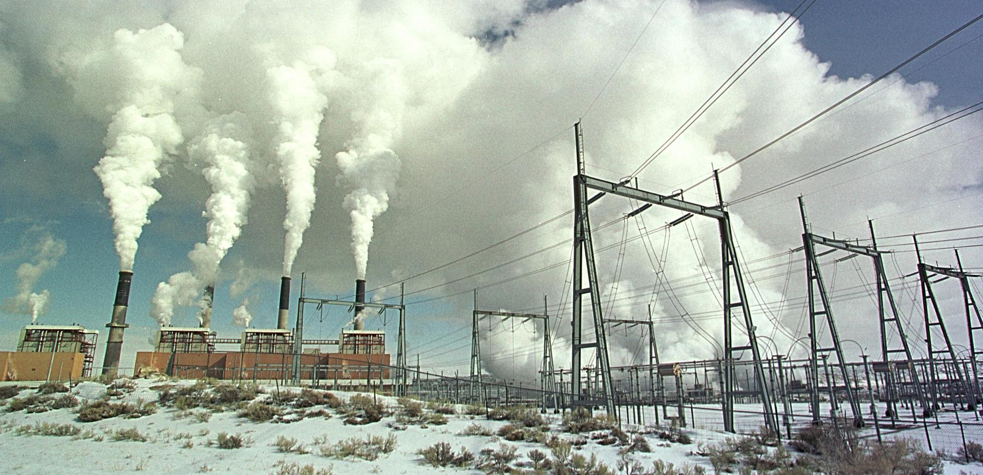 Stacks emit steam at the Jim Bridger Power Plant February 14, 2001 near Point of Rocks, Wyoming. PacifiCorp wants to shut down two of its units earlier than planned.  Photo by Michael Smith/Newsmakers