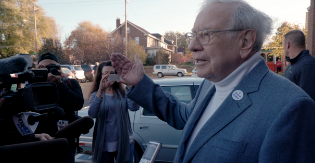 One Vote features Warren Buffett, who transports voters to the polls (Via GlobeNewswire)