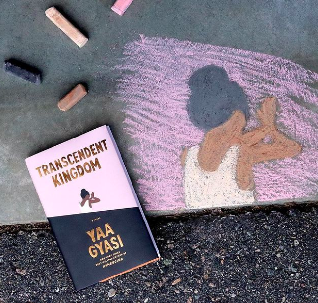 Transcendent Kingdom on pavement next to chalk drawing of its cover