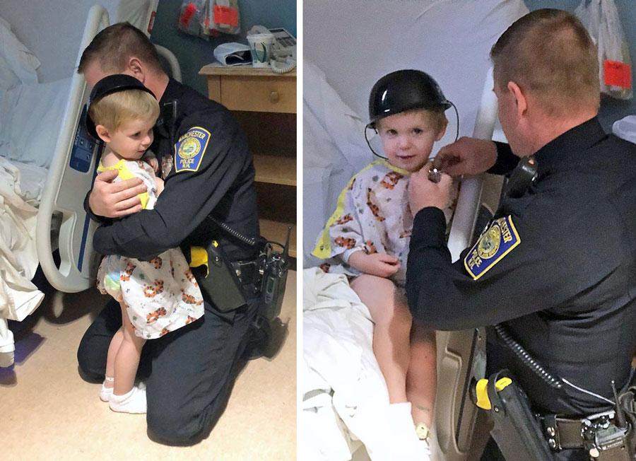 boy hugging police officer