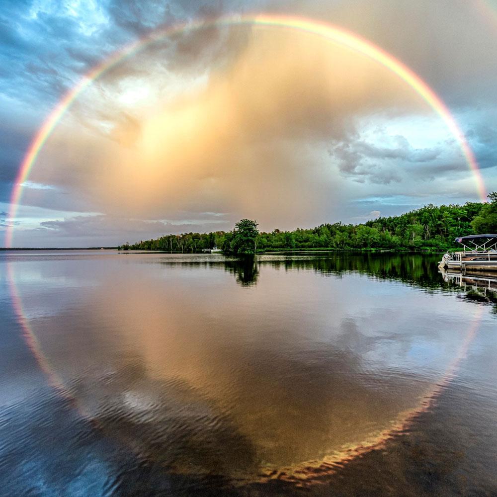 water reflecting rainbow