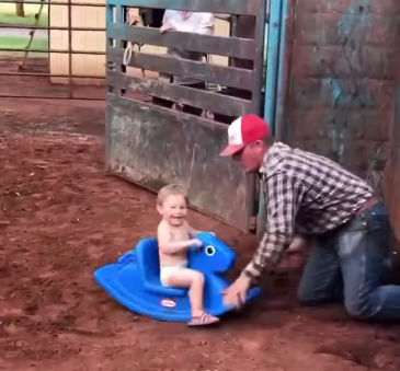 kid on rocking horse